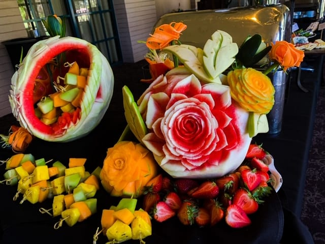 Fruit-carved buffet centerpieces by the event staff at Orange Tree Golf Club
